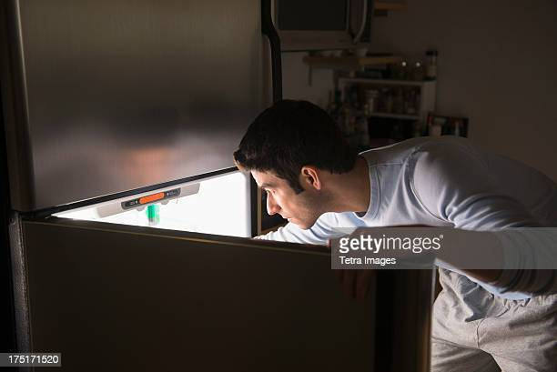 usa, new jersey, jersey city, man opening fridge at night - midnight stock pictures, royalty-free photos & images