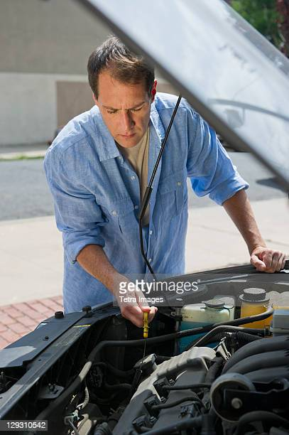 usa, new jersey, jersey city, man repairing car - oil change stock pictures, royalty-free photos & images