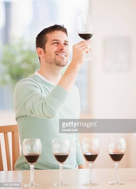 USA, New Jersey, Jersey City, Man tasting wine