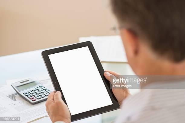 USA, New Jersey, Jersey City, Man using tablet pc