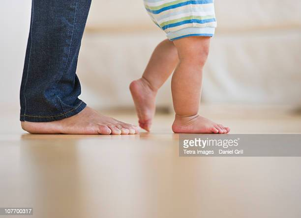 USA, New Jersey, Jersey City, Mother assisting in her son's (6-11 months) first steps