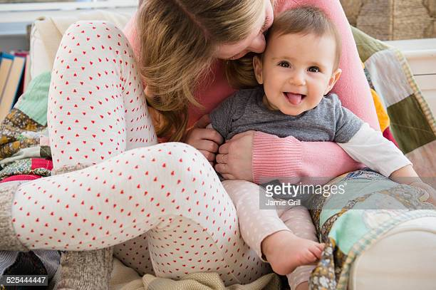 USA, New Jersey, Jersey City, Mother embracing baby girl (6-11 moths)