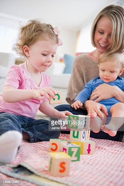 usa, new jersey, jersey city, mother playing with children (2-3, 6-11 months) at home - 6 11 months stock pictures, royalty-free photos & images