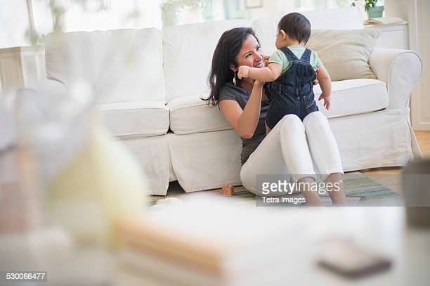 USA, New Jersey, Jersey City, Mother playing with her son (6-11 months) in living room