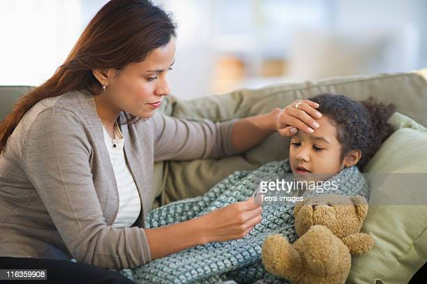 usa, new jersey, jersey city, mother taking daughter's (6-7) temperature - illness stock pictures, royalty-free photos & images