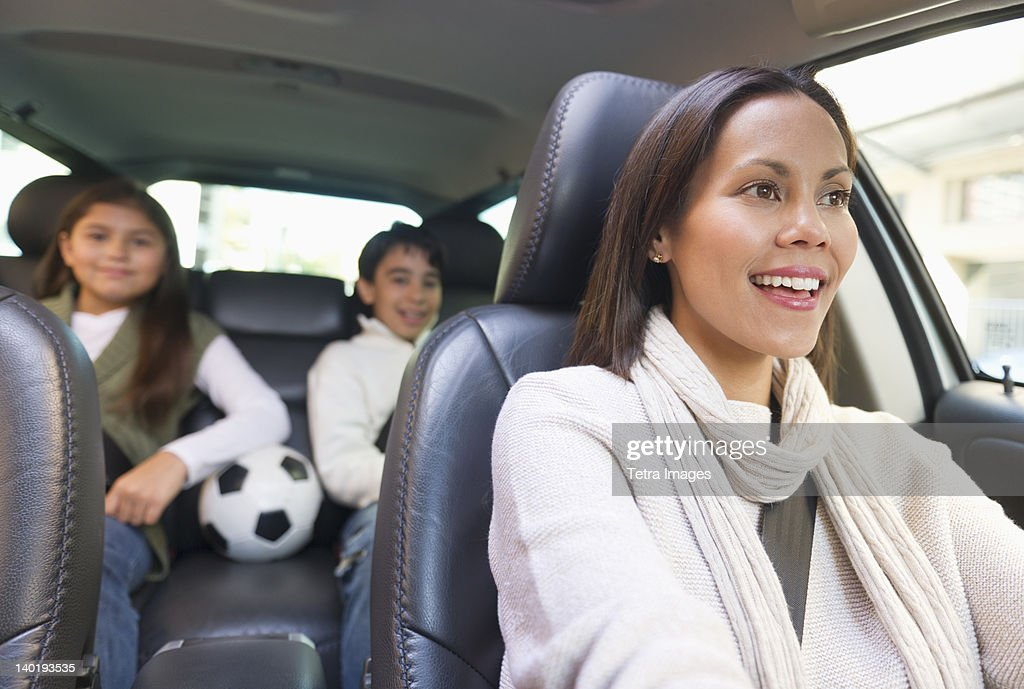 USA, New Jersey, Jersey City, Mother with son (12-13) and daughter (10-11) in car : Stock Photo