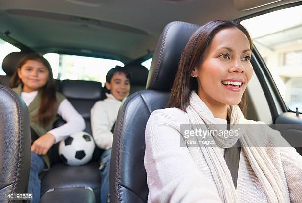 USA, New Jersey, Jersey City, Mother with son (12-13) and daughter (10-11) in car