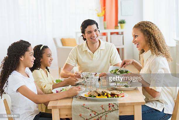 USA, New Jersey, Jersey City, Parents with daughters (10-13) eating dinner