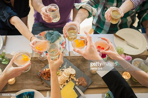 usa, new jersey, jersey city, people toasting at party - cocktail party stock pictures, royalty-free photos & images