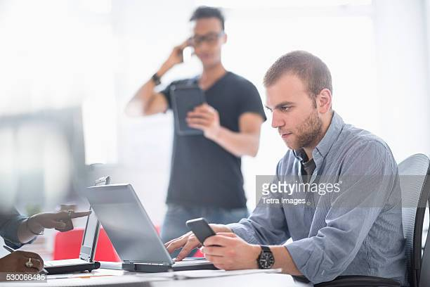 USA, New Jersey, Jersey City, People working in office