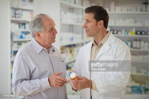 USA, New Jersey, Jersey City, Pharmacist explaining use of medicine to patient