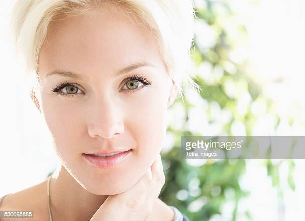 USA, New Jersey, Jersey City, Portrait of blonde woman smiling