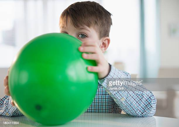 USA, New Jersey, Jersey City, Portrait of boy (4-5) blowing balloon