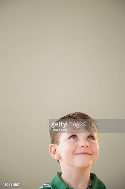 USA, New Jersey, Jersey City, Portrait of boy (4-5) daydreaming