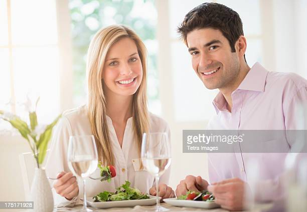 USA, New Jersey, Jersey City, Portrait of couple eating dinner in restaurant