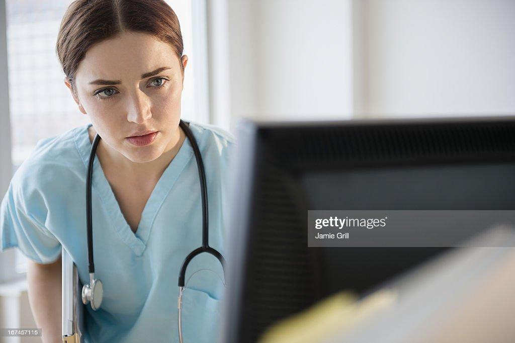 USA, New Jersey, Jersey City, Portrait of female doctor in hospital uniform : Stock Photo