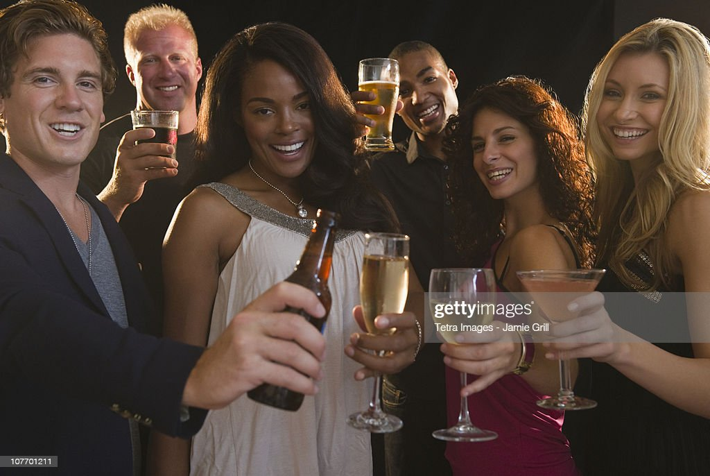 USA, New Jersey, Jersey City, Portrait of friends celebrating with champagne at nightclub : Stock Photo