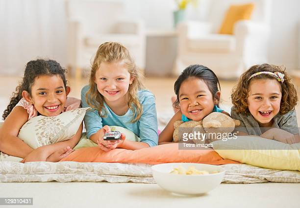 usa, new jersey, jersey city, portrait of girls (6-9) watching tv - children only stock pictures, royalty-free photos & images
