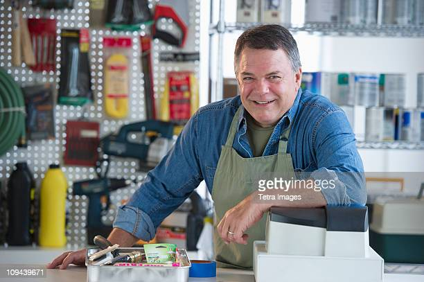 USA, New Jersey, Jersey City, Portrait of hardware shop owner at counter