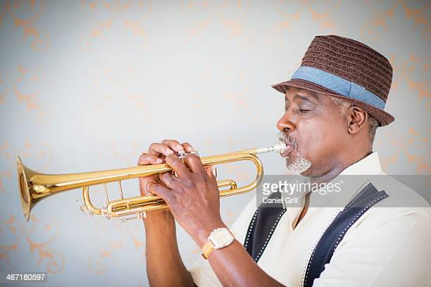 usa, new jersey, jersey city, portrait of man playing trumpet - wind instrument stock pictures, royalty-free photos & images