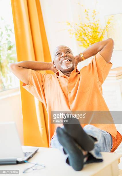 usa, new jersey, jersey city, portrait of men sitting with feet up - head back stock pictures, royalty-free photos & images