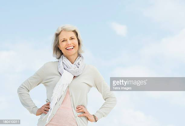 USA, New Jersey, Jersey City, Portrait of senior woman standing outdoors