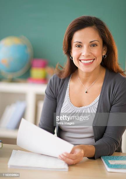 USA, New Jersey, Jersey City, portrait of smiling female teacher in classroom