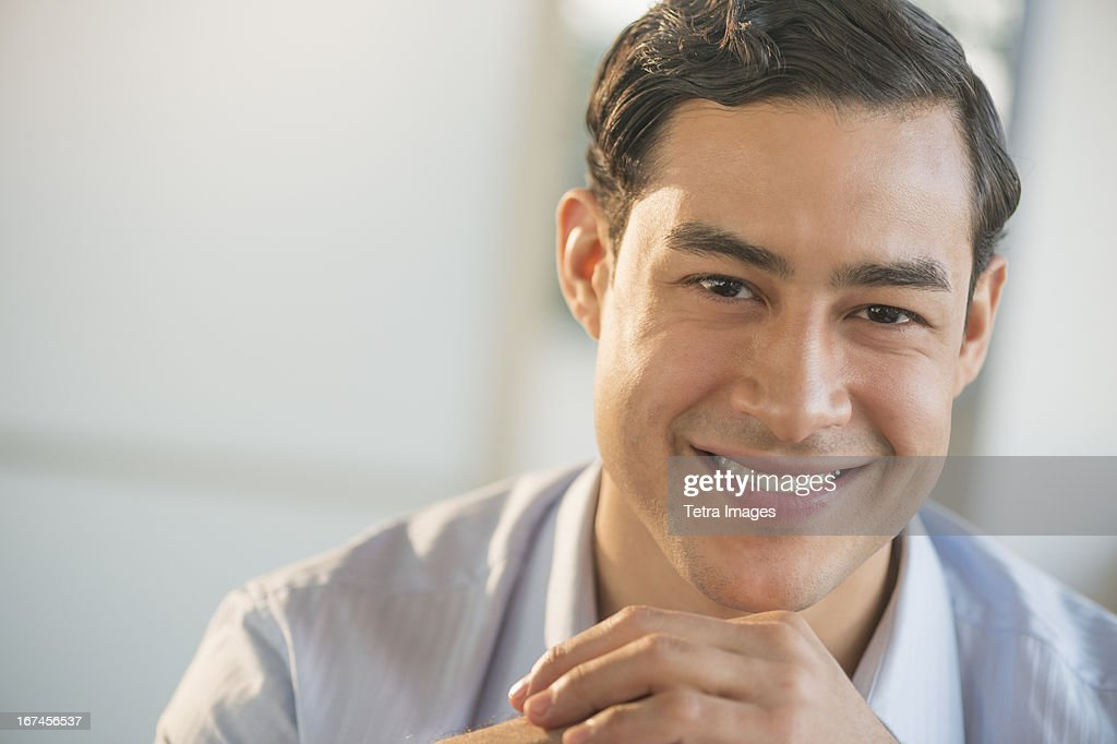 USA, New Jersey, Jersey City, Portrait of smiling male executive in office : Stock Photo
