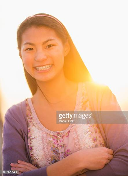 USA, New Jersey, Jersey City, Portrait of smiling teenage girl ( 16-17 years)