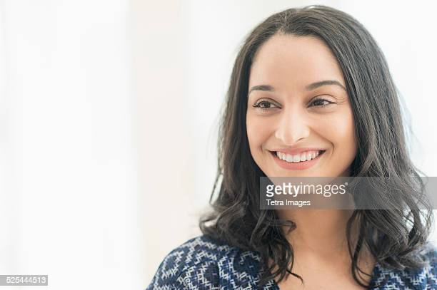 USA, New Jersey, Jersey City, Portrait of smiling young woman