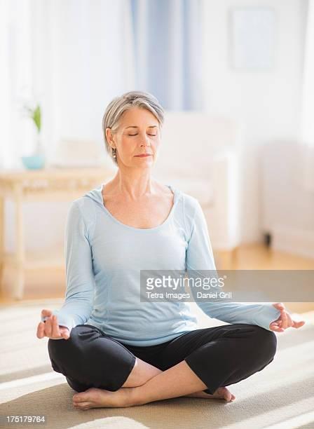 USA, New Jersey, Jersey City, Portrait of woman doing yoga
