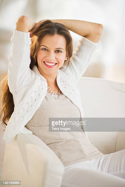 USA, New Jersey, Jersey City, Portrait of woman relaxing in chair