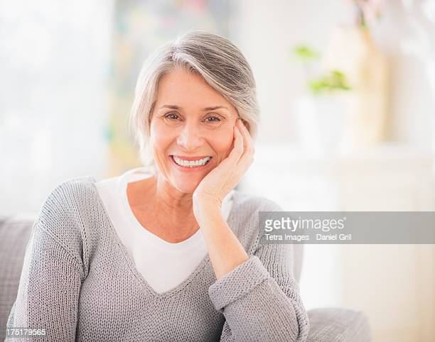USA, New Jersey, Jersey City, Portrait of woman relaxing on sofa