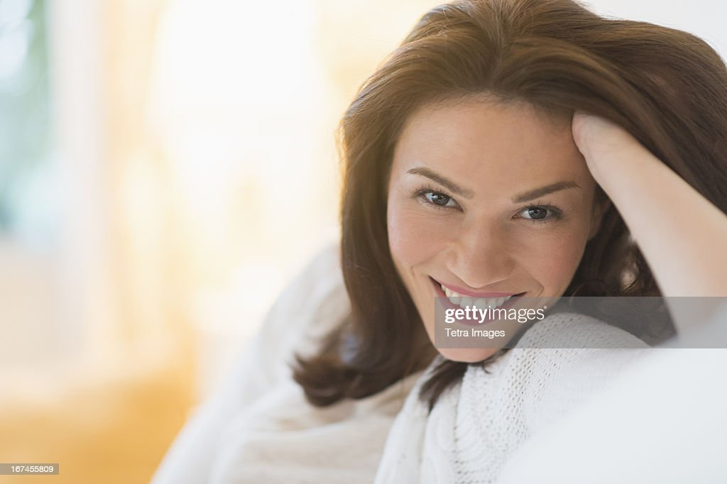 USA, New Jersey, Jersey City, Portrait of woman sitting on sofa : Stock Photo