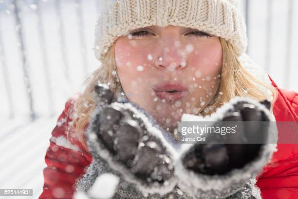 USA, New Jersey, Jersey City, Portrait of woman wearing knit hat blowing snow