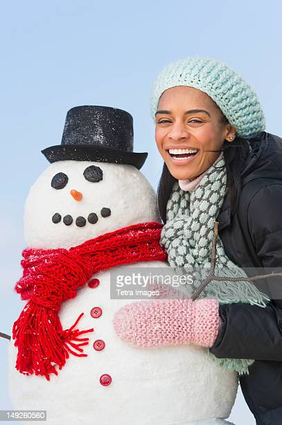 USA, New Jersey, Jersey City, Portrait of woman with snowman