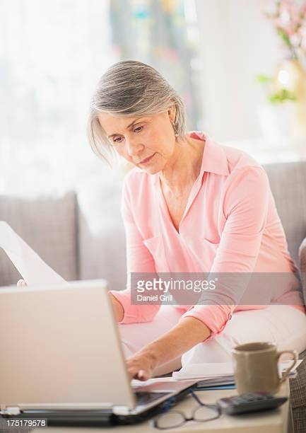 USA, New Jersey, Jersey City, Portrait of woman working at home