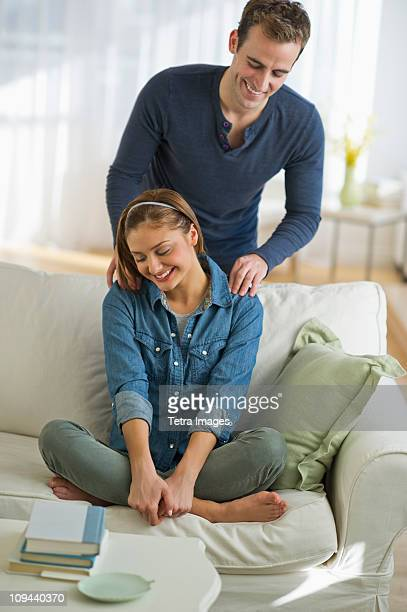 usa, new jersey, jersey city, portrait of young couple relaxing on sofa - massage rooms photos et images de collection