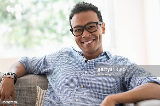 USA, New Jersey, Jersey City, Portrait of young relaxed man smiling