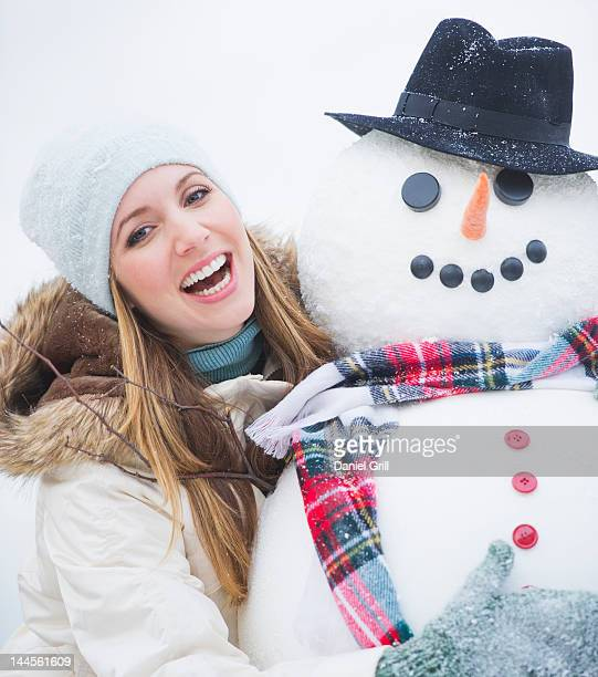 USA, New Jersey, Jersey City, portrait of young woman with snowman