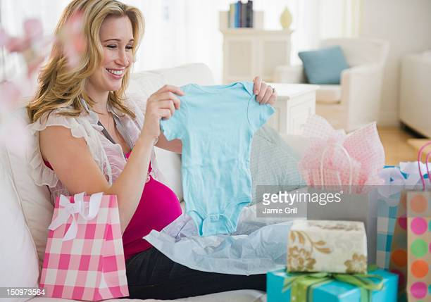 usa, new jersey, jersey city, pregnant woman unpacking gifts - baby shower stock pictures, royalty-free photos & images