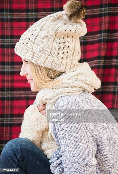 USA, New Jersey, Jersey City, Profile of woman wearing knit hat and scarf