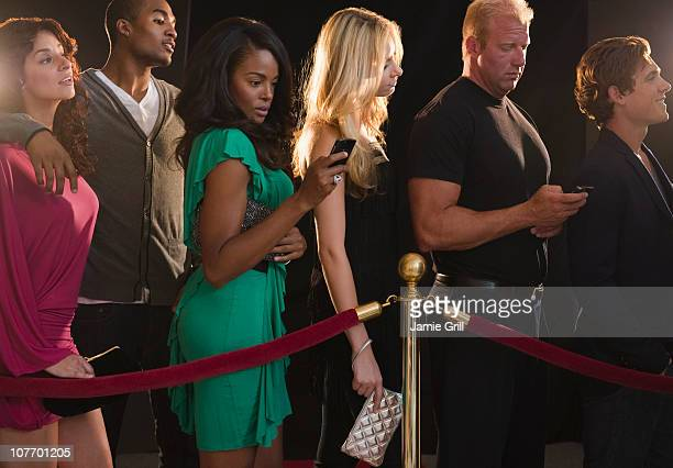 USA, New Jersey, Jersey City, Queue of people waiting outside nightclub