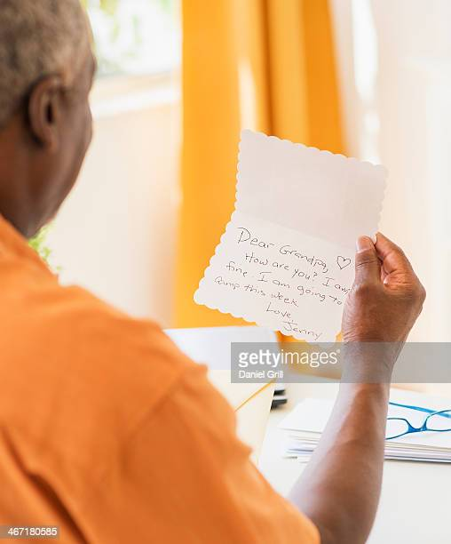 USA, New Jersey, Jersey City, Rear view of man reading message