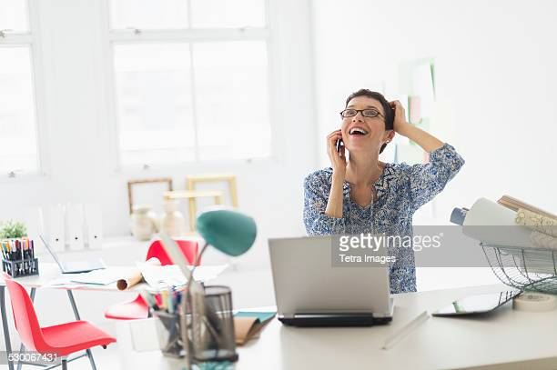 usa, new jersey, jersey city, senior business woman using cell phone in office - open blouse stock photos and pictures