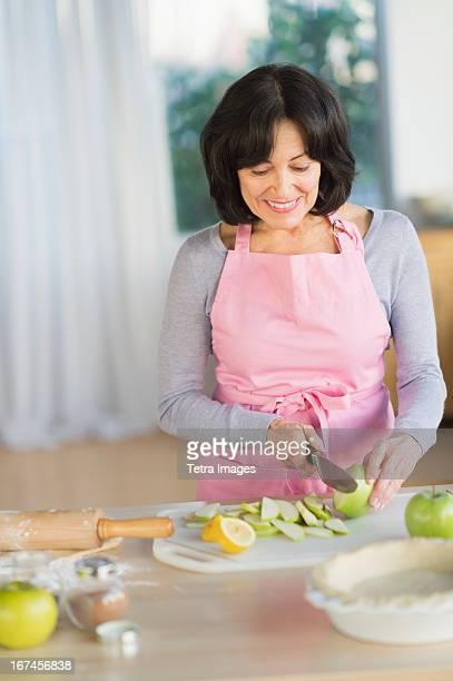 USA, New Jersey, Jersey City, Senior woman baking