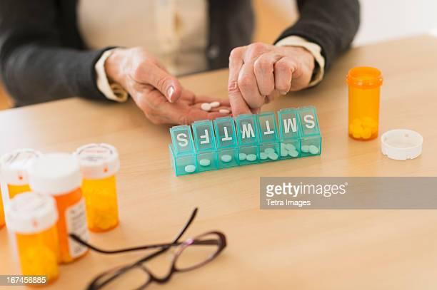 USA, New Jersey, Jersey City, Senior woman dozing pills