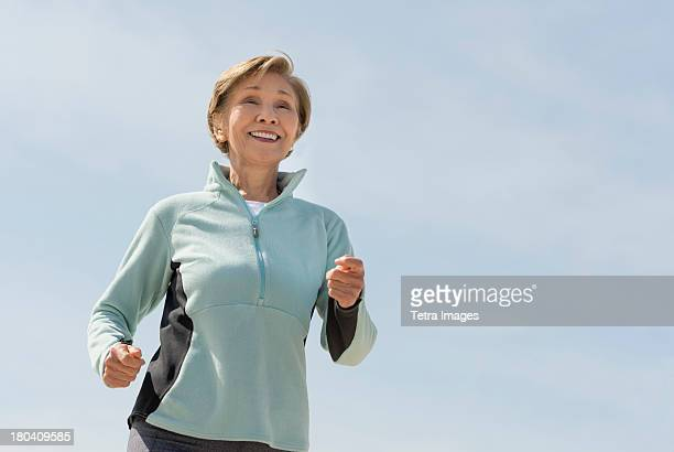 USA, New Jersey, Jersey City, Senior woman jogging
