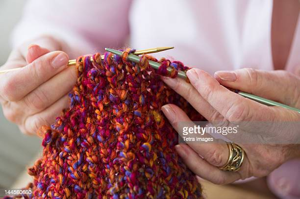 usa, new jersey, jersey city, senior woman knitting, close-up - knitting stock photos and pictures
