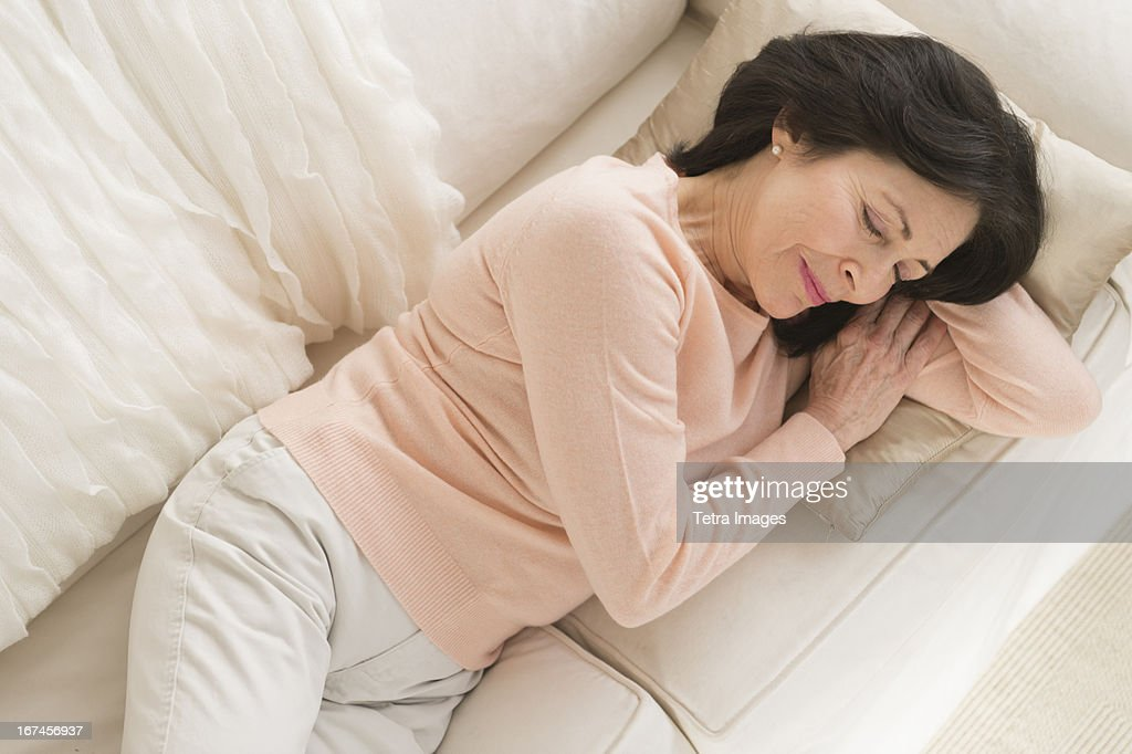 USA, New Jersey, Jersey City, Senior woman napping on sofa : Stock Photo